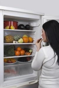 Woman and full fridge