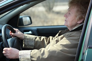 elderly woman drive in car